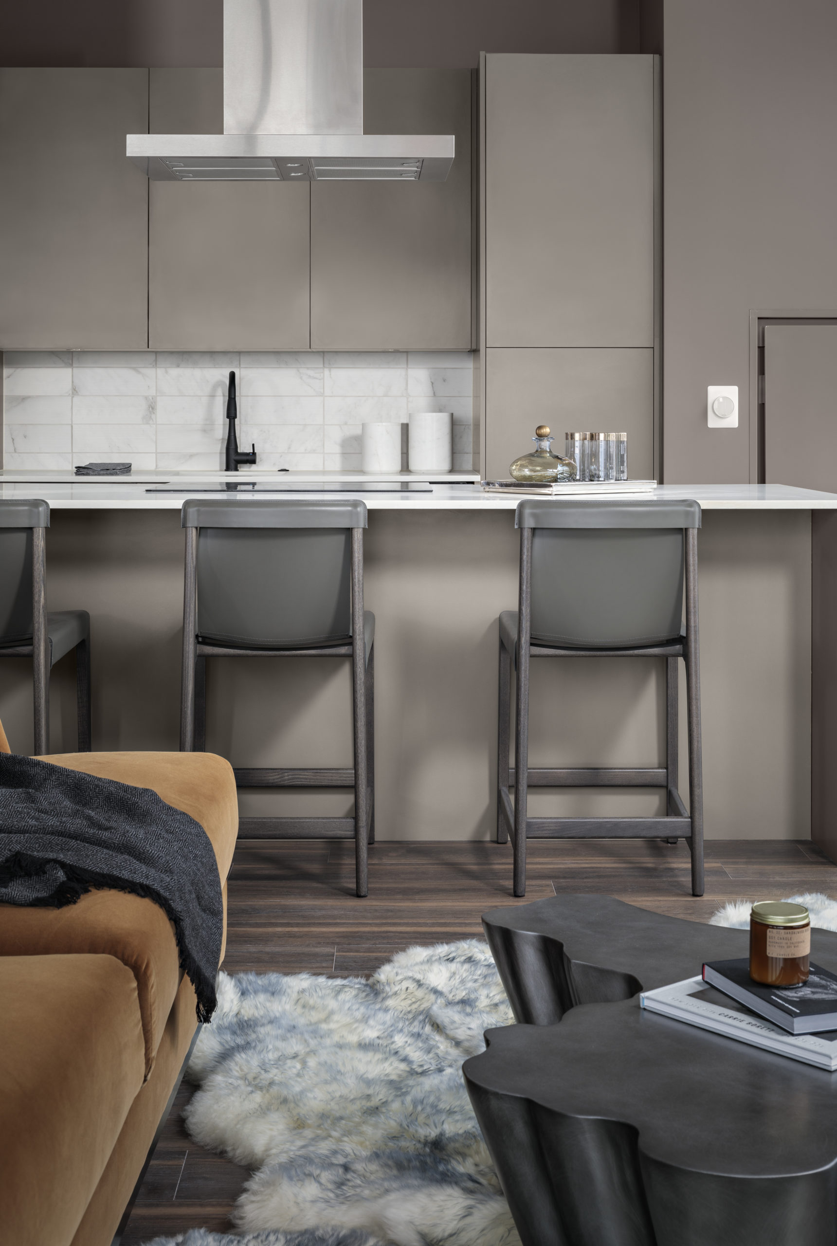 kitchen island with chairs and luxury finishes