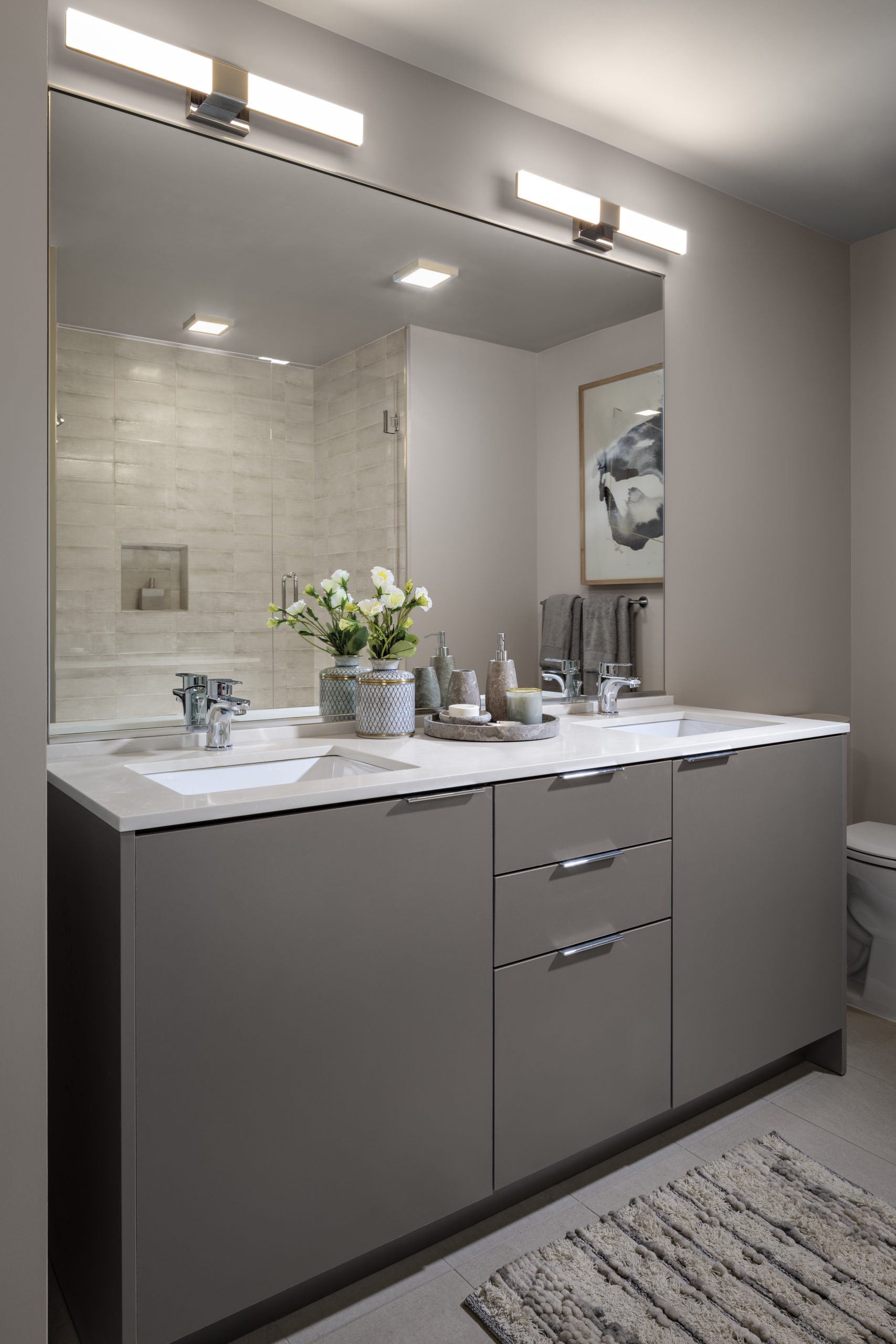 luxury apartment bathroom gray cabinets with white counters